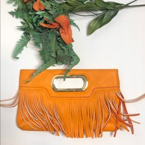 Charming Charlie orange fringe clutch bag
